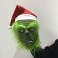 Máscara do Grinch com gorro de Papai Noel.