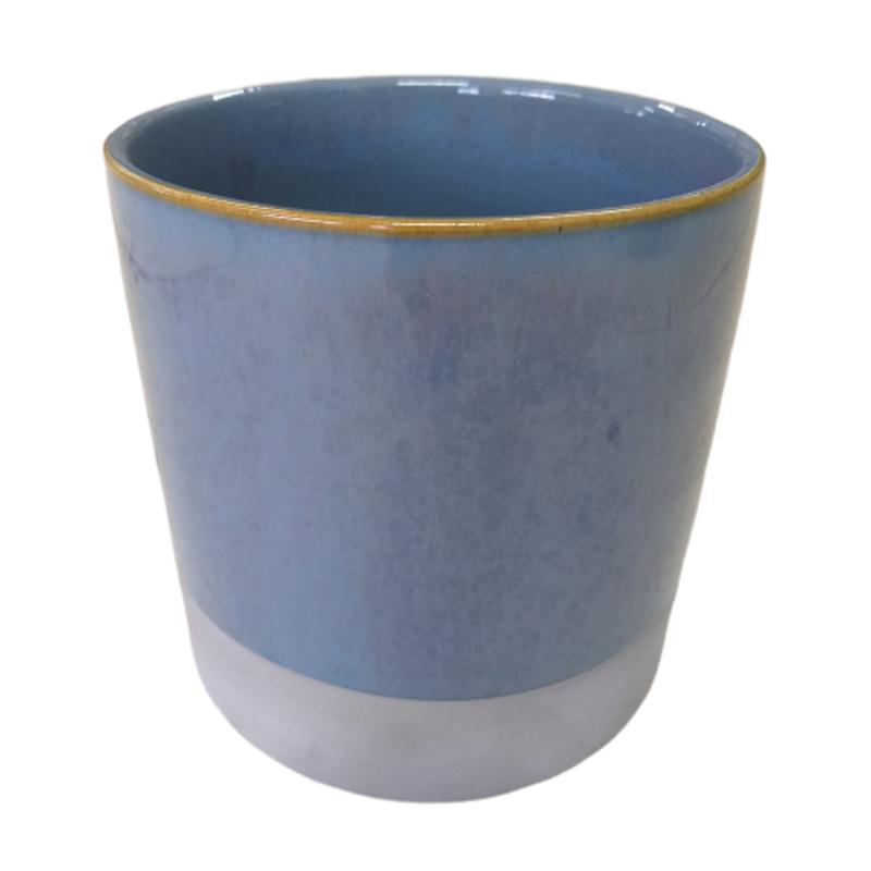 Cachepot de cerâmica azul com acabamento em cimento na base