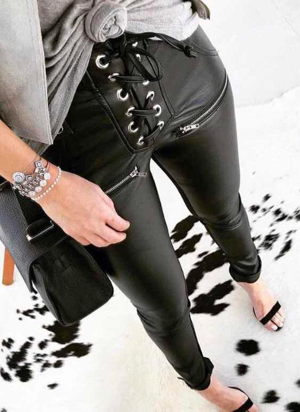 Calça couro ilhós black