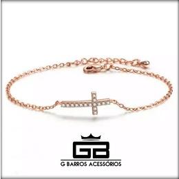 Pulseira cruz com banho de ouro rosa e cristais de zirconia