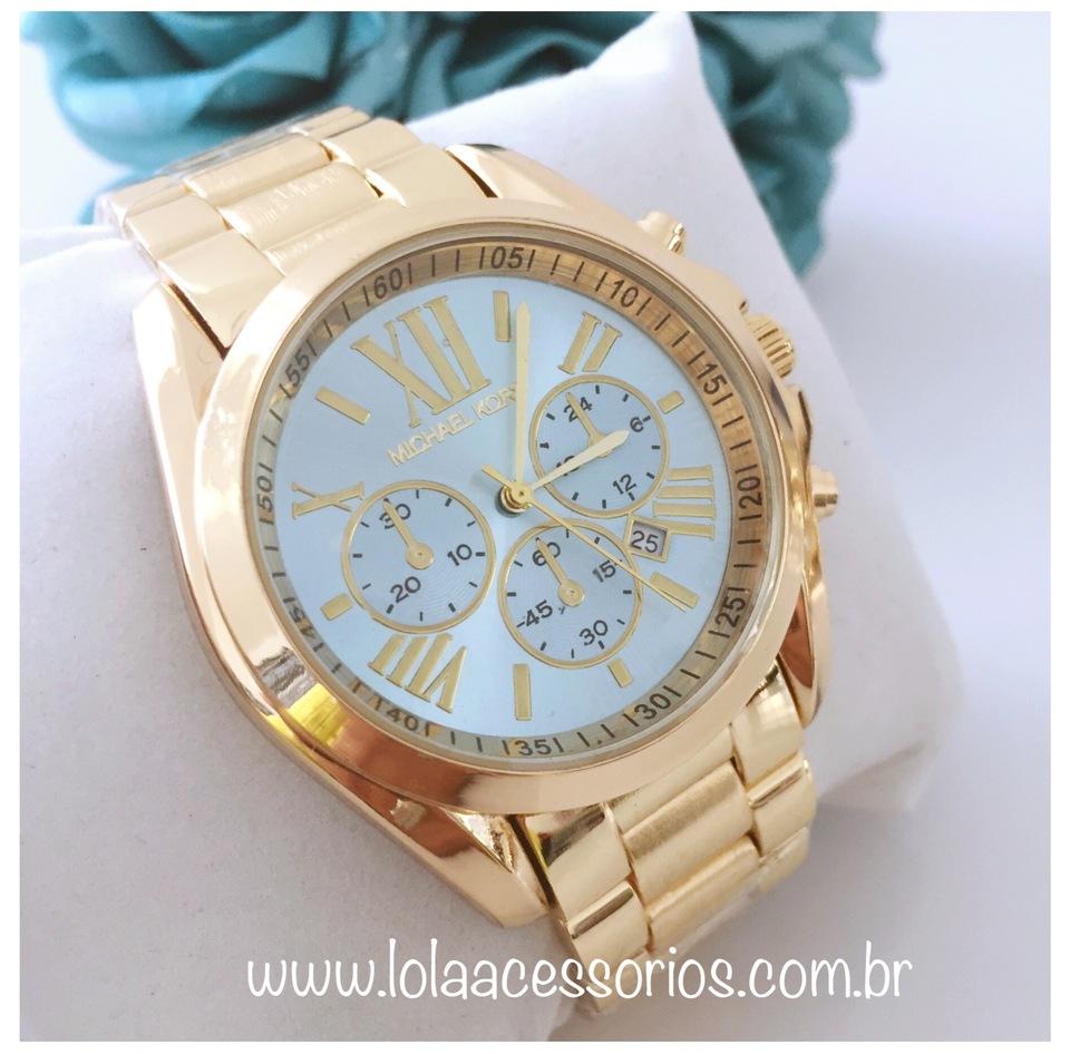 9a0cc5f4715 Relógio MK Dourado Fundo Azul Bebê Relógio MK Dourado Fundo Azul Bebê ...