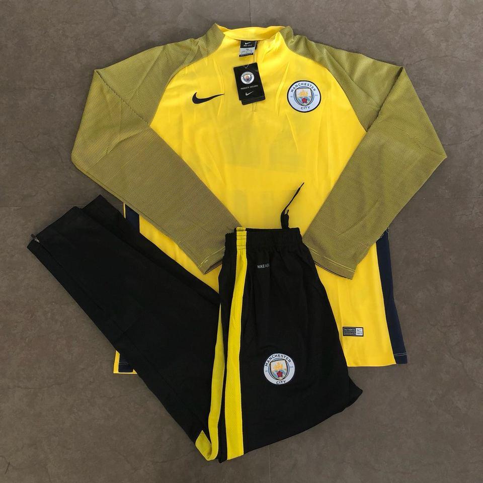 Agasalho Manchester City Nike Amarelo e Preto - MWgrifes - Aqui é Top! f690fdc822fe9